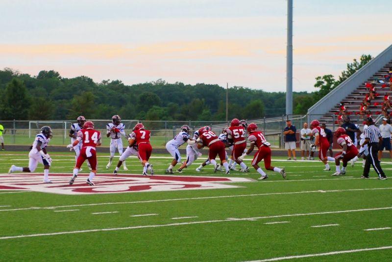 Bastrop quarterback drops back to pass