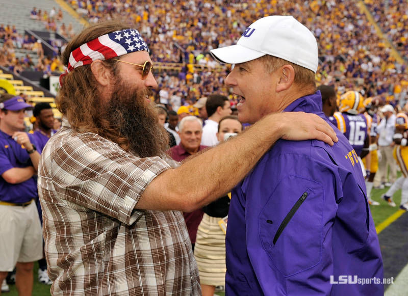 ULM alumnus and Duck Dynasty star Willie Robinson and LSU coach Les Miles visit prior to kickoff of the ULM at LSU game