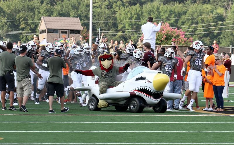 Ace the Warhawk Mascot leads out the ULM Warhwaks to open the 2014 season (800x498).jpg