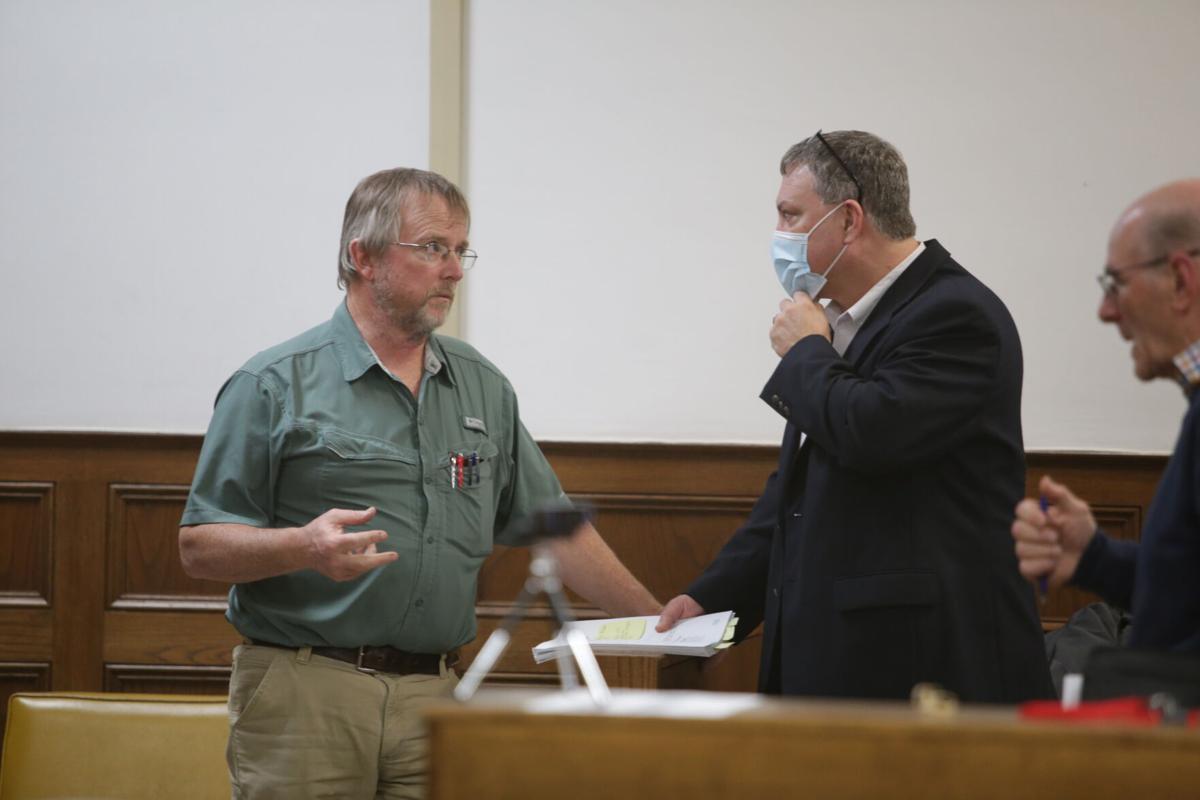 Parish Consulting Engineer Kevin Crosby speaks with Parish Treasurer Brad Cammack.JPG