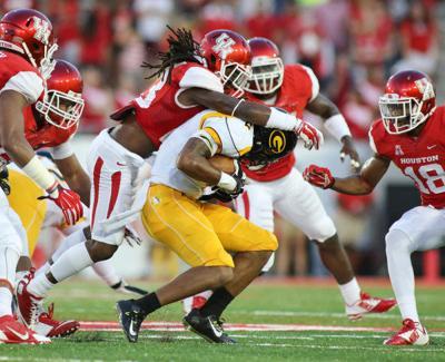 The University of Houston defense sacks the Grambling quarterback