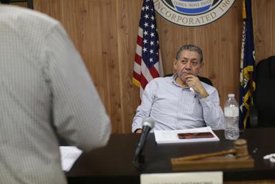 Sterlington Mayor Caesar Velasquez listens to fiscal administrator Junior Shelton.JPG