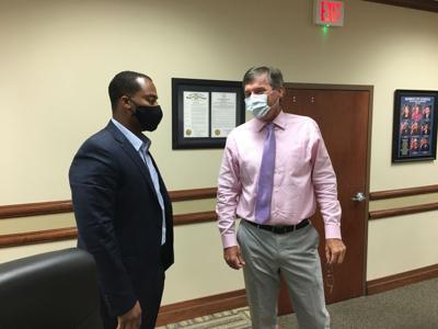 Superintendent Brent Vidrine speaks with Board member Brandon Johnson.jpg