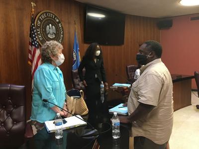 Mayor Jamie Mayo speaks with Monroe City Council member Gretchen Ezernack.jpeg