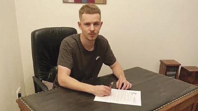 HLGU men's basketball signs international player
