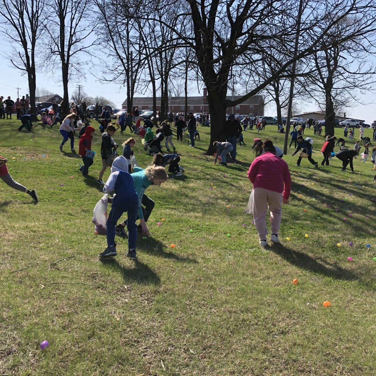 Children happy to find candy and cash at Easter egg hunt