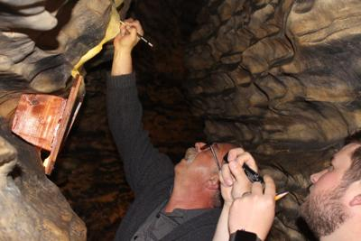 Mark Dodson adds signature to Mark Twain Cave