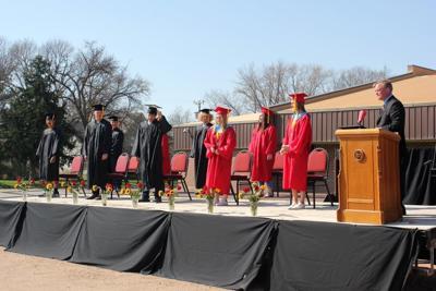 Red Cloud graduation standing