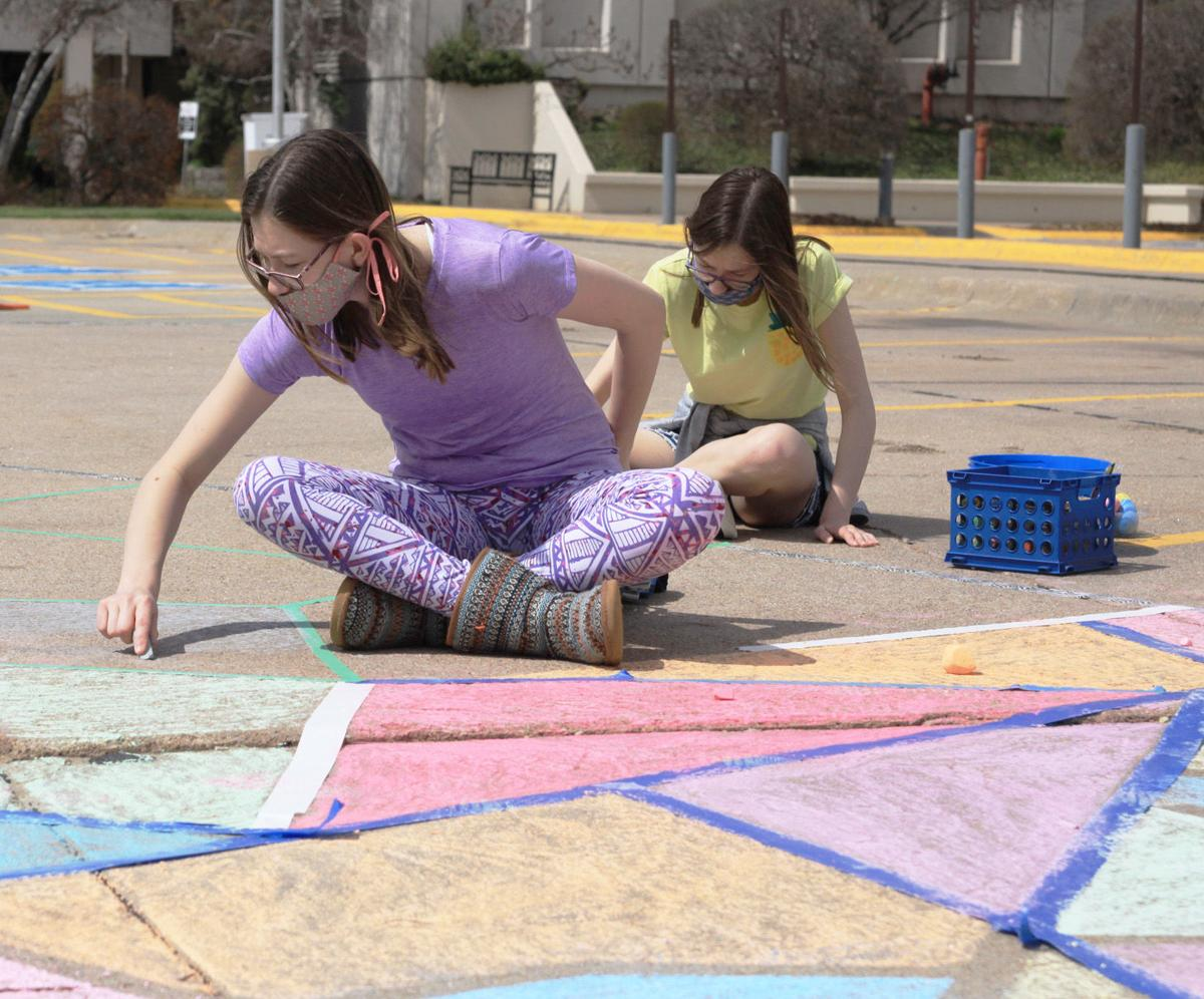Hastings' chalk crew hoping to spread cheer, inflict joy