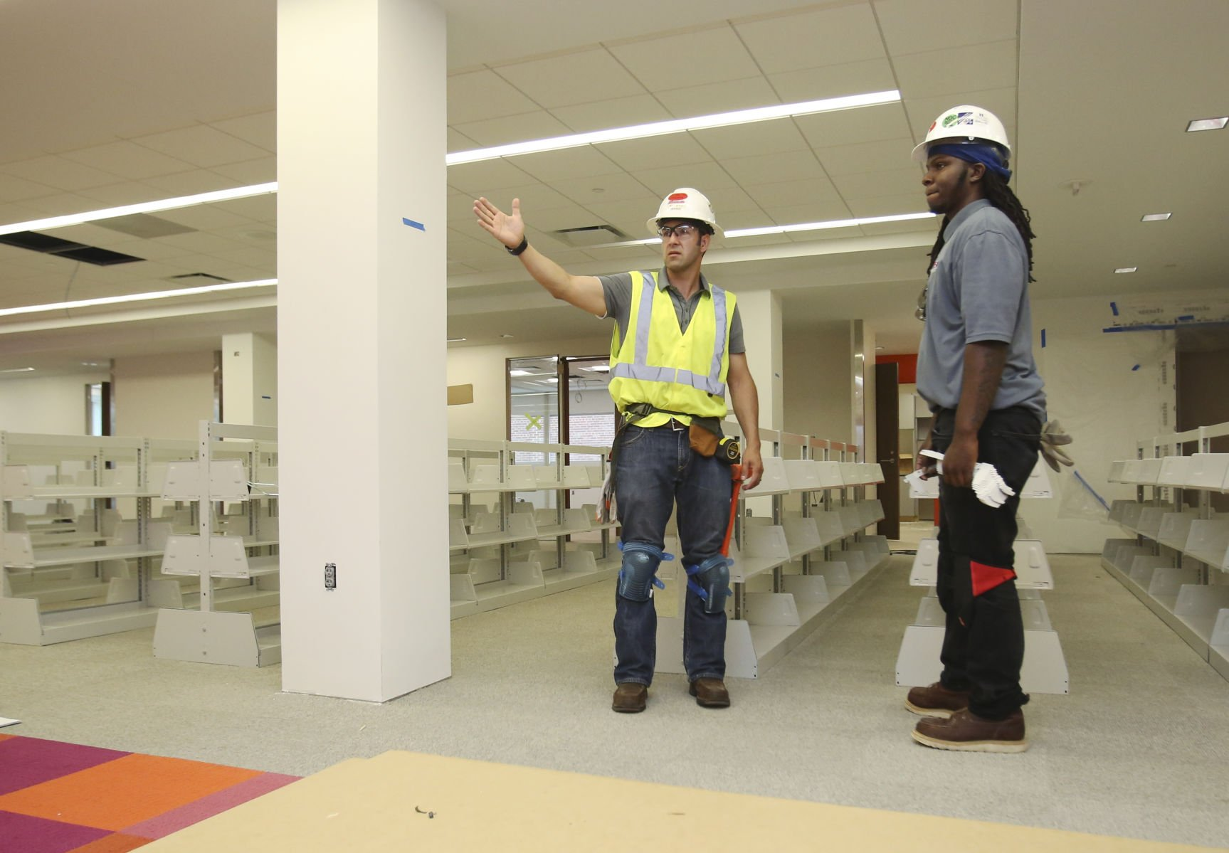 Isaac Ortega, Field Supervisor, And Darrion Freeman, Lead Installer, From Midwest  Storage Solutions, Inc. Of Omaha, Discuss Spacing Of The Shelves In The ...