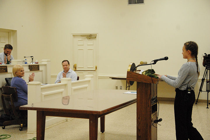 Recycling proposal presented to commissioners by sixth grade student