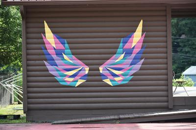 Local artist paints wings to inspire hope