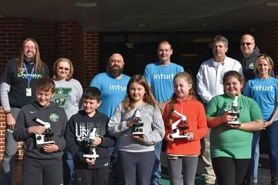 SYKES and Intuit donate microscopes to Viper Elementary students