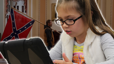 Child watching US Capitol Violence on iPad