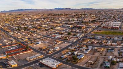 PHOTO: Aerial view of Barstow community a residential city of homes and commercial property community Mojave desert California