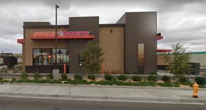 Dunkin Donuts robbed at gunpoint; suspects then carjacks a man