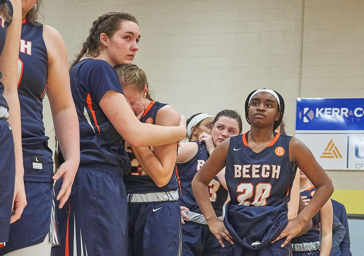 Beech players watch Brentwood players celebrate as Laci Walmer consoles her teammate Mia Dean Saturday night and DeShiya Hoosier looks on.