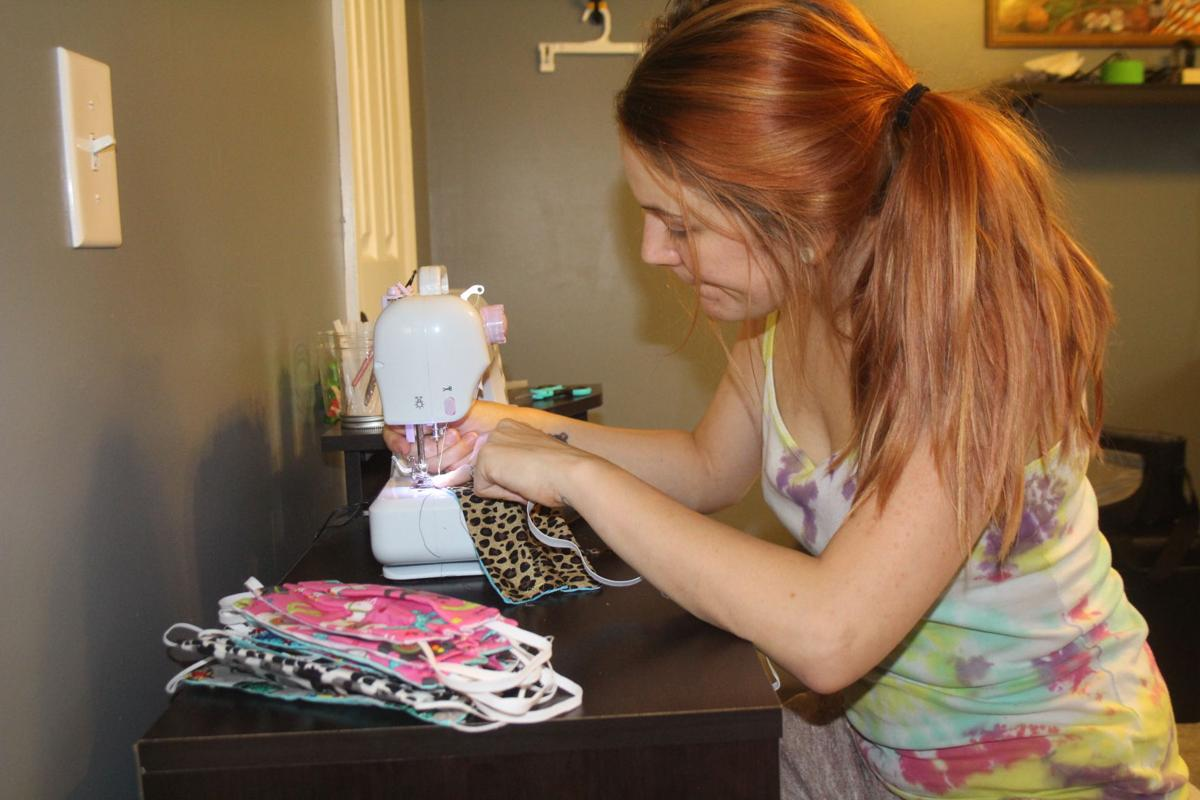 Mandy Womble crafts masks at her home work station. She got the idea to help those in need after seeing the shortage of masks across the state.