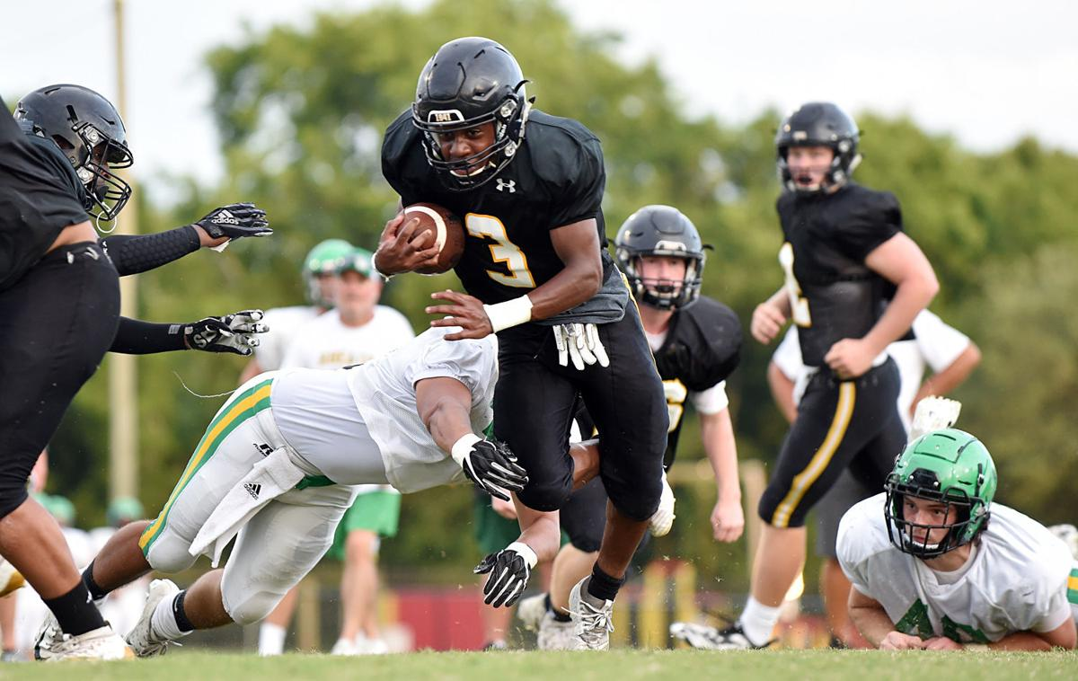 Keion Stafford runs the ball for the Commando offense against Rhea County.