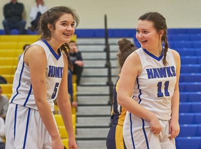 Merrol Hyde's Peyton Mingle, left, and Olivia Short share a laugh during Thursday night's game.