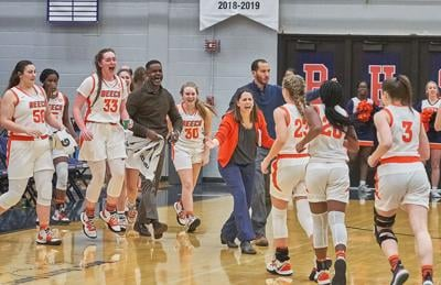 Beech players and coaches celebrate during a time-out after jumping out to a commanding lead early against Henry County.