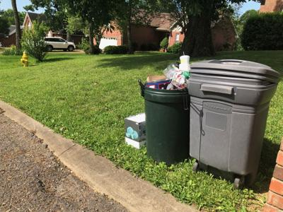 Some residents experienced delays in their trash pick-up service this week. TENA LEE