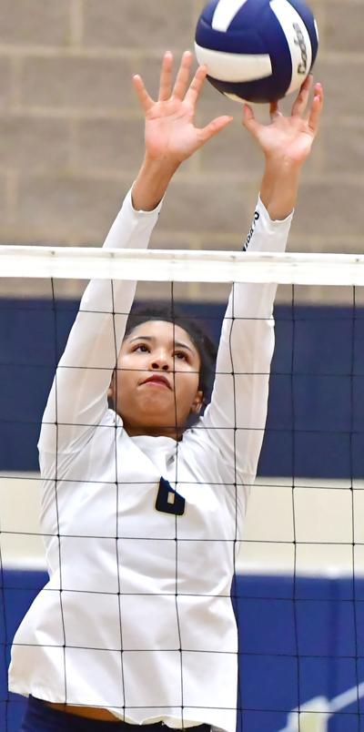 Maygan Miller blocks a ball.