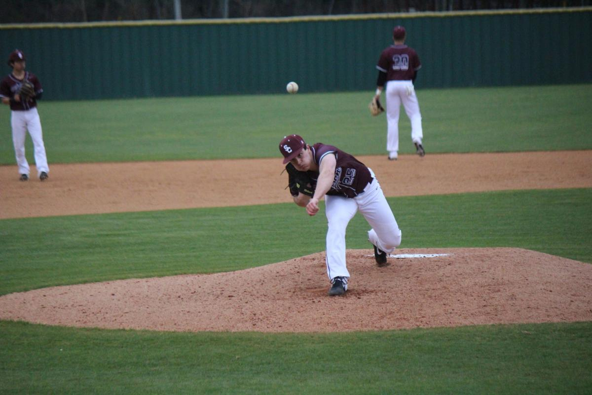 Ryan Ginther throws a warm up pitch for the Bison.