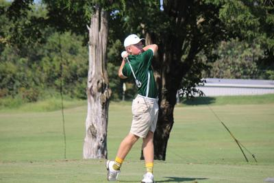 Colton Werner, Gallatin High School, watches his iron shot on hole 6 at Blue Grass Country Club during the 2109 season.