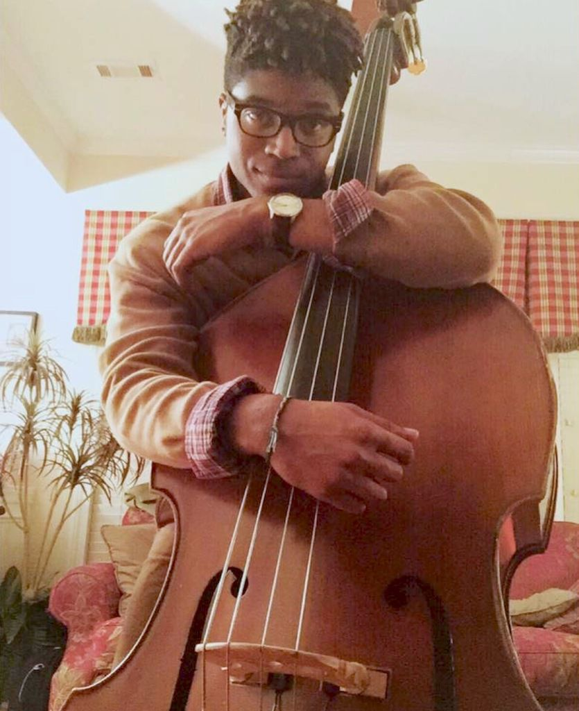 Cellist returns to his high school orchestra to teach
