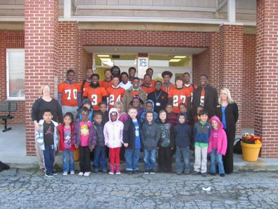 Stockbridge High football players mentor youngsters