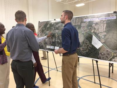 Residents view plans for Rock Quarry Road widening, air concerns with median breaks