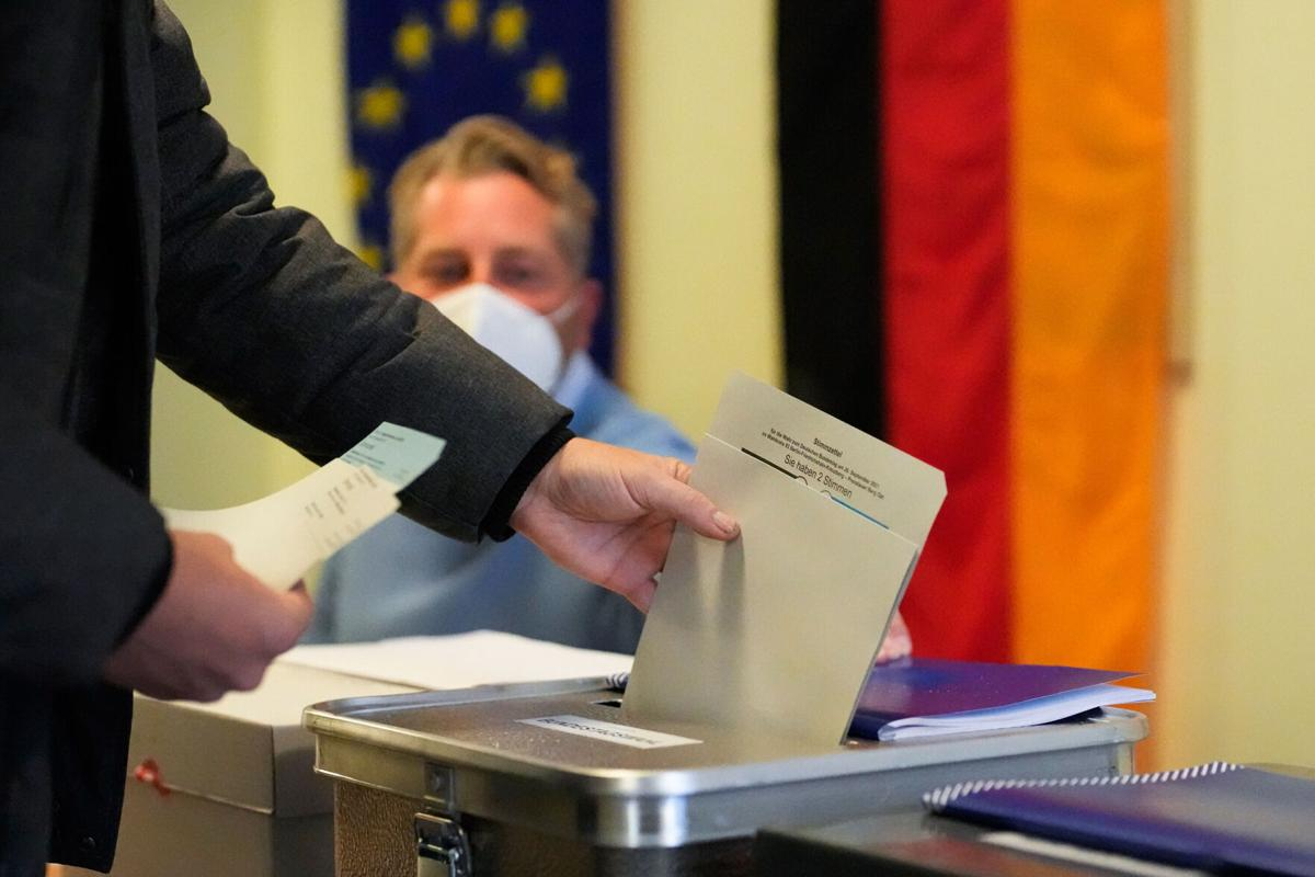 SPD narrowly ahead in exit polls as voting ends in Germany's landmark election but final result uncertain