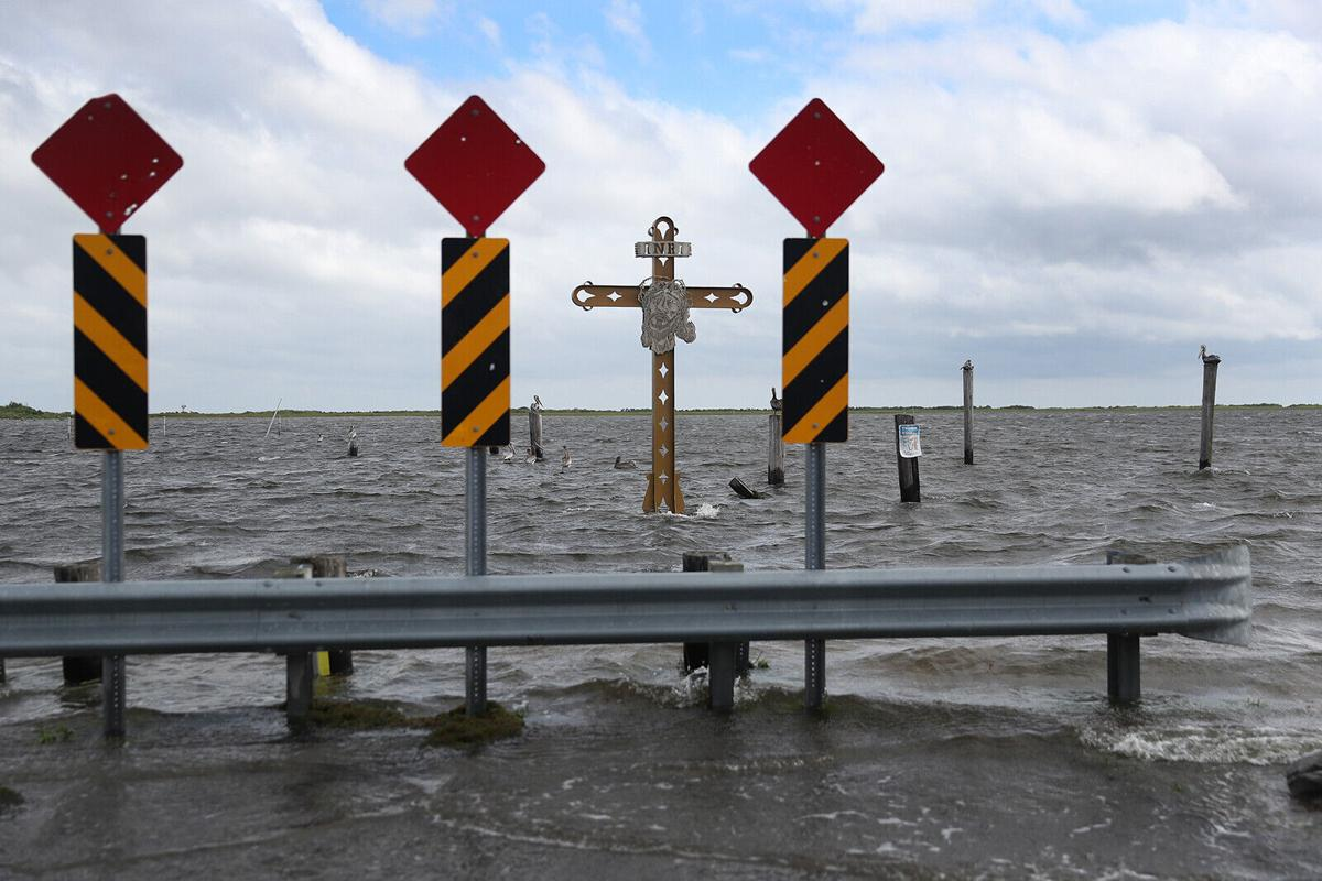 A crawling Hurricane Sally is threatening a 'historic rainfall event' in parts of the Gulf Coast