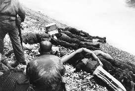 The price of freedom - American dead on Omaha Beach.jpg