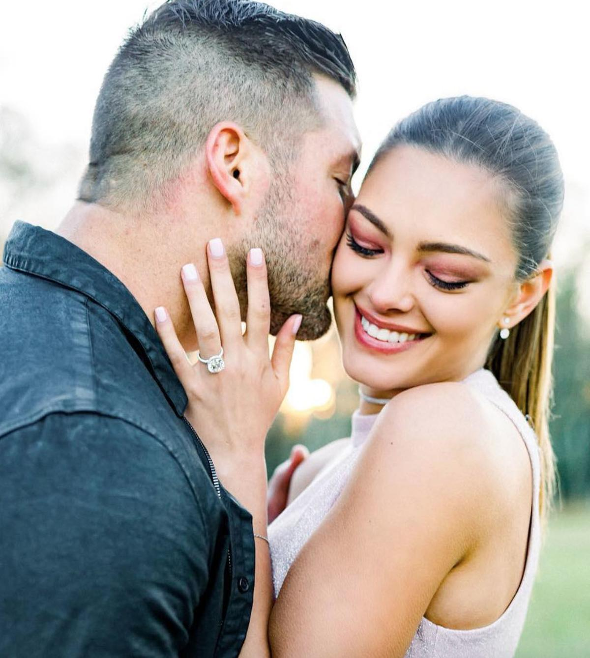 PHOTOS Tim Tebow Proposes To Miss Universe Demi Leigh