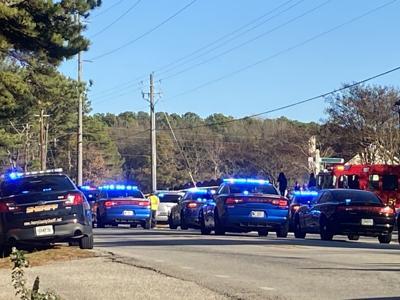 Alleged gunman in custody following Racetrack Road shooting, 3-car wreck