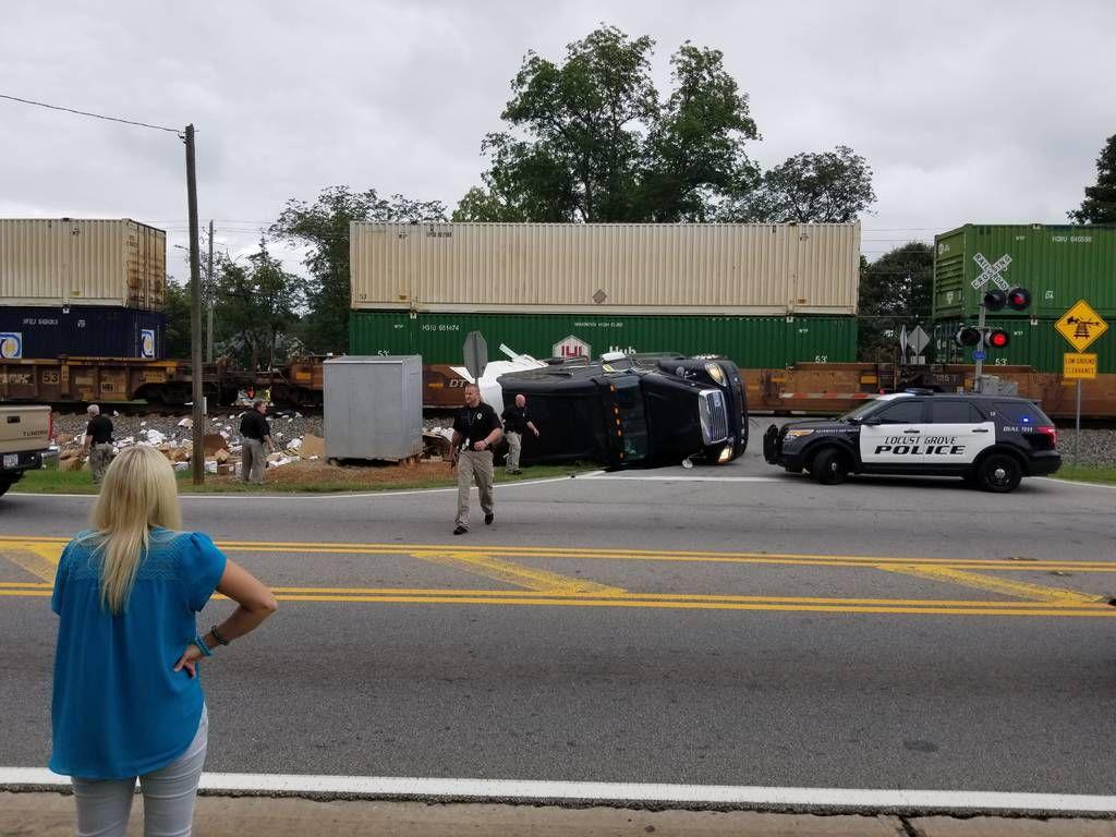 Train truck crash shuts down parts of ga 42 in locust grove