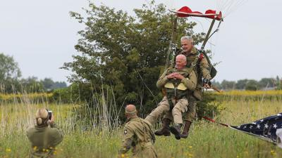 A 97-year-old vet jumped out of a plane to recreate his D-Day parachute drop