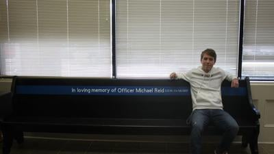 Josh Reid refurbishes Henry County Police benches in memory of cop dad for Eagle Scout project