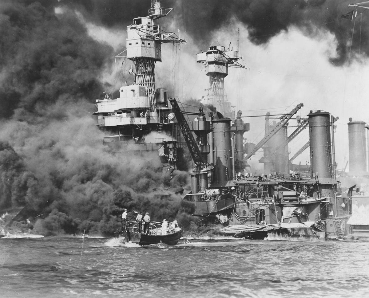 A small boat rescues a seaman from the 31,800 ton USS West Virginia after the attack on Pearl Harbor, December 7, 1941.