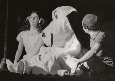 """Herald-Dispatch file photo Mary Wilson as Lucy and Gary Wilson as Charlie Brown have a bit of fun with Snoopy (Huck Raines) in a """"Peanuts"""" skit, part of the 1975 edition of """"Gay Capers,"""" the annual variety show presented by the Junior Department of the Woman's Club of Huntington."""