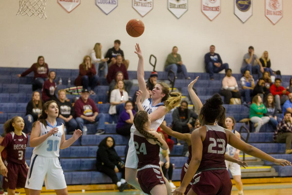 Photos: High School Basketball, Spring Valley girls team faces Woodrow Wilson