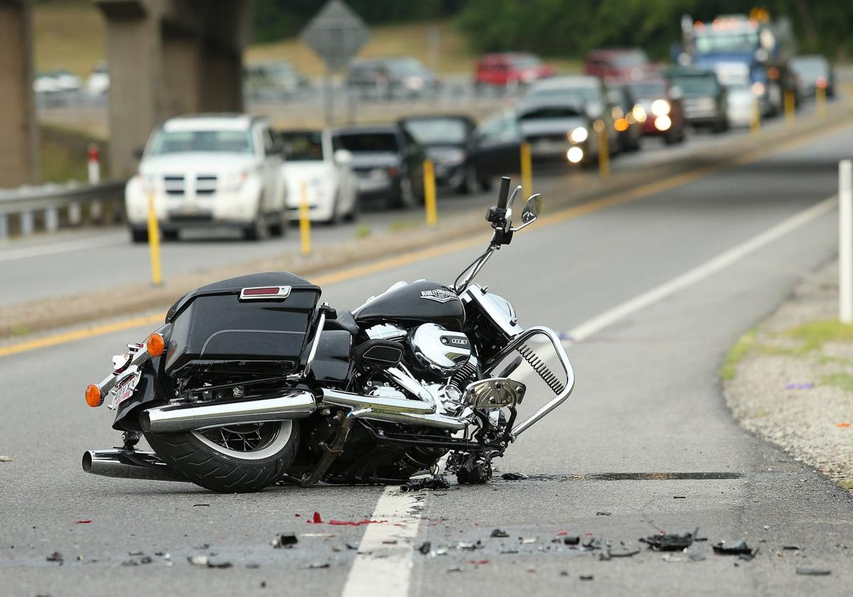 Motorcycle crashes after steel beam falls from semi on