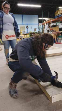 Boston College students spend spring break with Habitat For Humanity