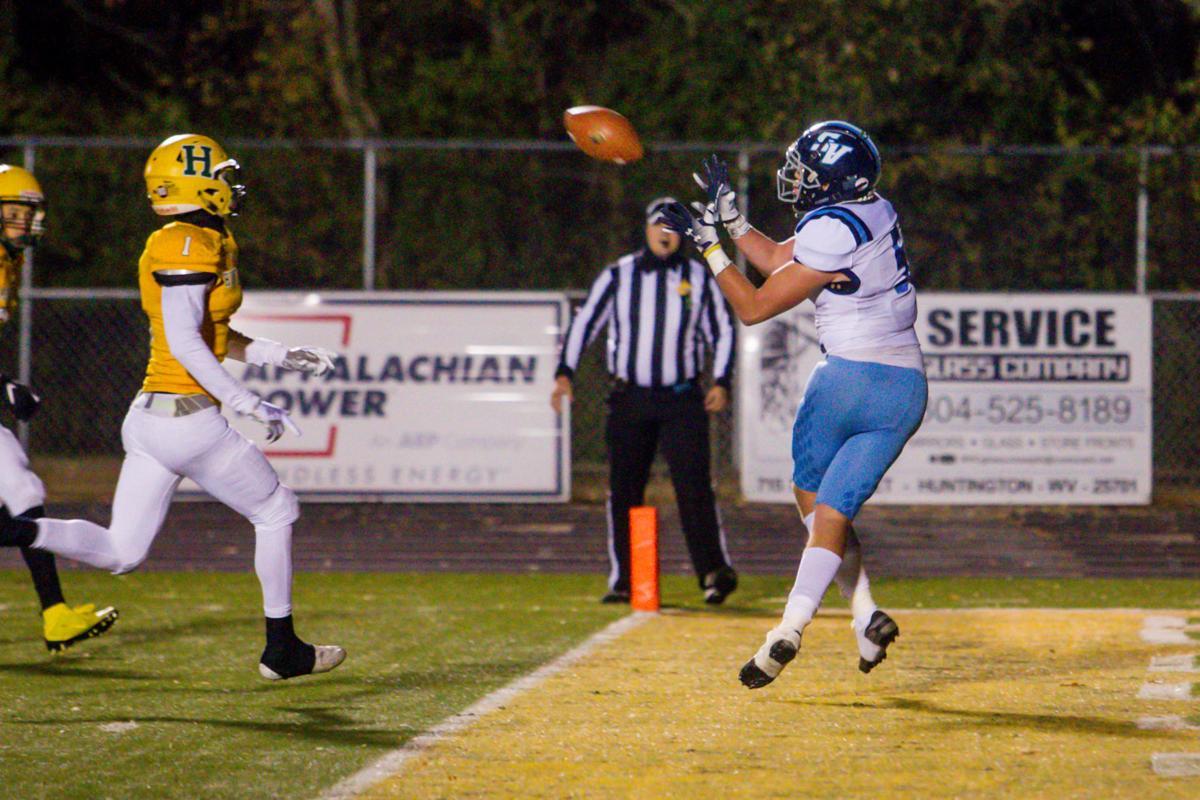 Photos: High School Football, Huntington and Spring Valley face off