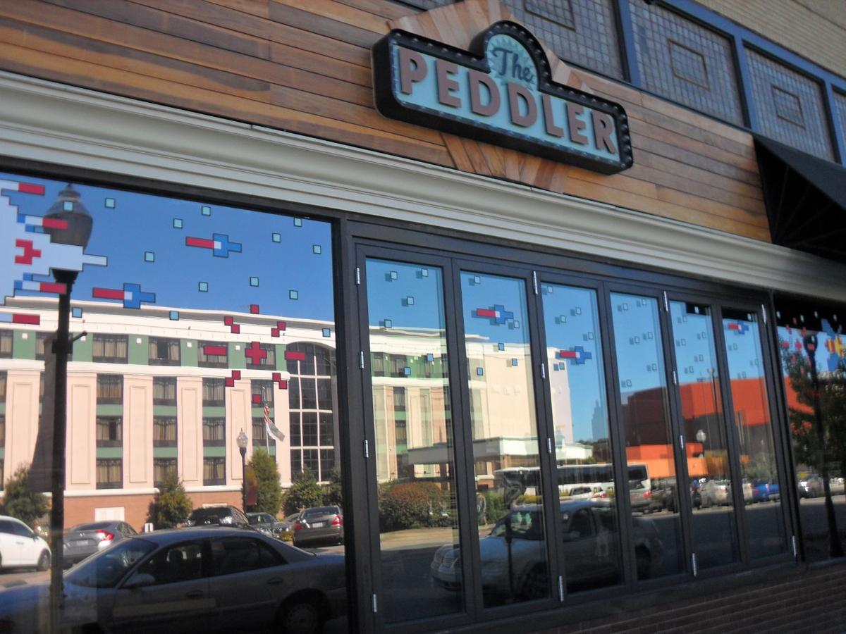 the peddler returns with burgers an arcade bar and brews dining