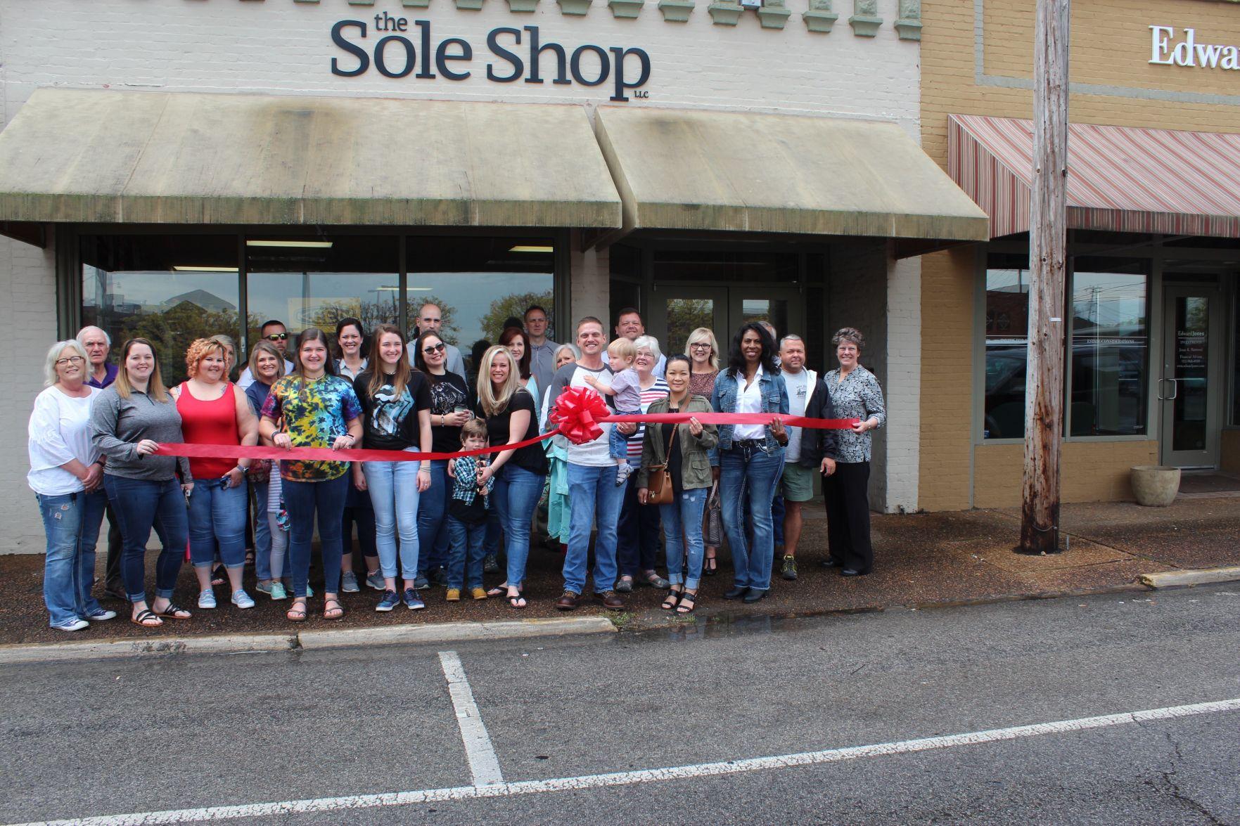 Ribbon cutting the sole shop