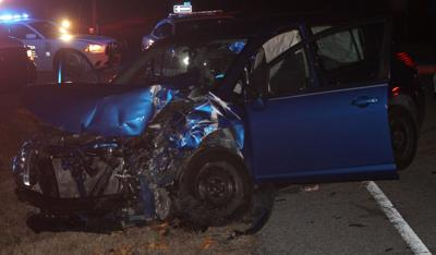 Nissan Versa extensive damage pic