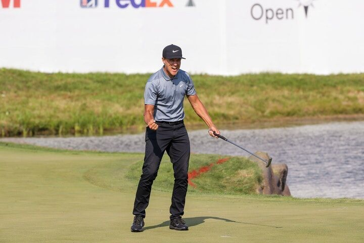 Cameron Champ celebrated after making his final putt at the 18th hole to win the 3 M Open at TPC Twin Cities in Blaine on Sunday.